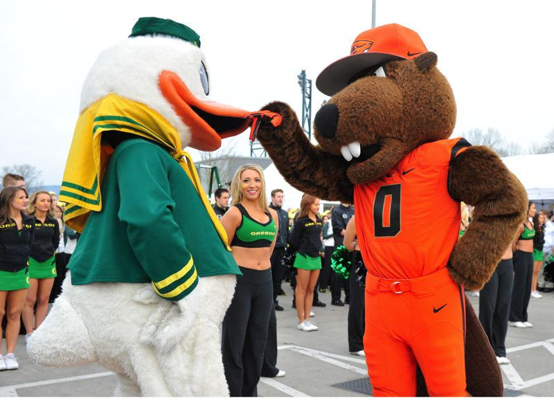 by: COURTESY OF JOHN LARIVIERE - The Duck (left) and Benny Beaver talk football.