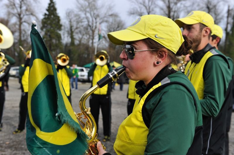 by: COURTESY OF JOHN LARIVIERE - Bree Mohr of the Oregon band plays with her school's flag affixed to her saxophone.