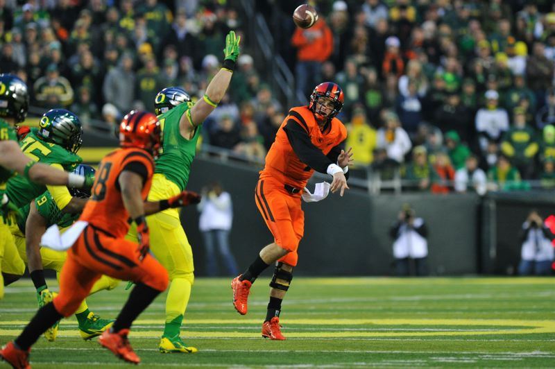 by: COURTESY OF JOHN LARIVIERE - Sean Mannion passes to Oregon State teammate Terron Wood in the first quarter.