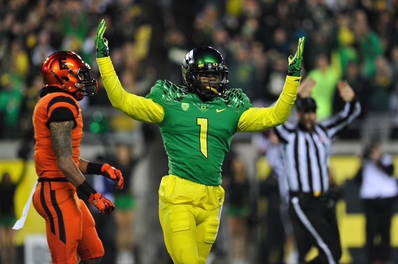 by: COURTESY OF JOHN LARIVIERE - Oregon's Josh Huff celebrates after a long gainer in the first half.