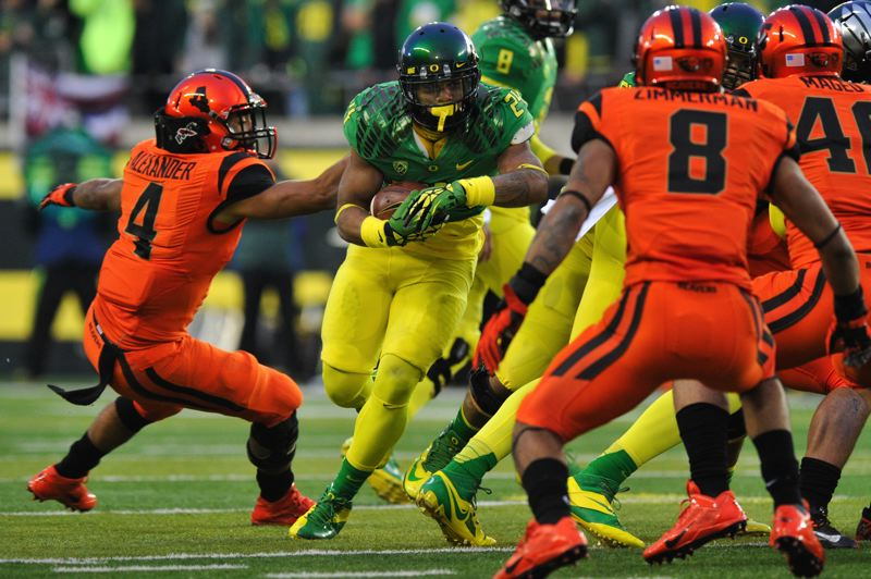 by: COURTESY OF JOHN LARIVIERE - Oregon's Thomas Tyner picks up yardage inside.
