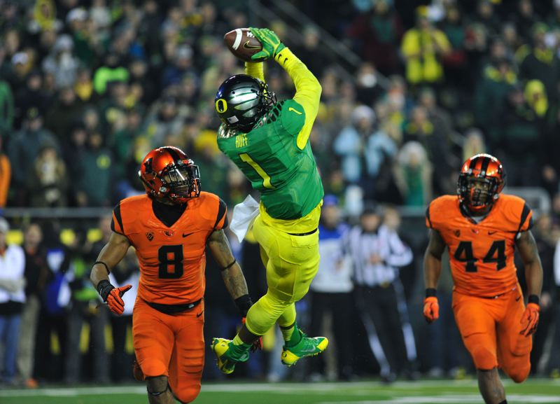 by: COURTESY OF JOHN LARIVIERE - Oregon's Josh Huff pulls in the winning touchdown catch with 29 seconds to go Friday night, as the Ducks rally to defeat Oregon State 36-35 at Autzen Stadium. OSU's Tyrequek Zimmerman (left) and Jabral Johnson are on defense but unable to break up the pass from Marcus Mariota.