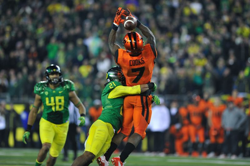 by: COURTESY OF JOHN LARIVIERE - Oregon State's Brandin Coos, hit by Oregon's Avery Patterson, just misses a catch on the Beavers' final possession.