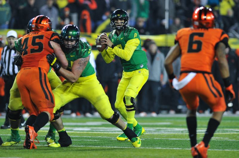 by: COURTESY OF JOHN LARIVIERE - Oregon's Marcus Mariota sets up to throw on the Ducks' winning drive.