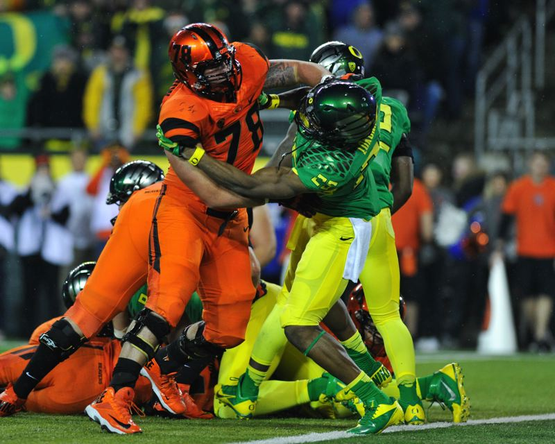 by: COURTESY OF JOHN LARIVIERE - OSU offensive lineman Sean Harlow blocks Oregon linebacker Boseko Lokombo.