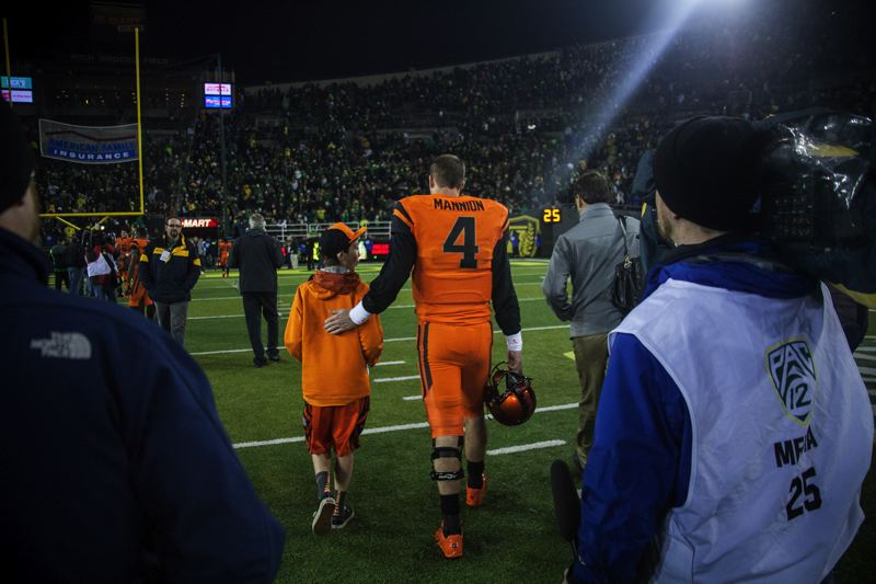 by: COURTESY OF MEG WILLIAMS - Oregon State quarterback Sean Mannion walks off the field after the 36-35 loss to Oregon.