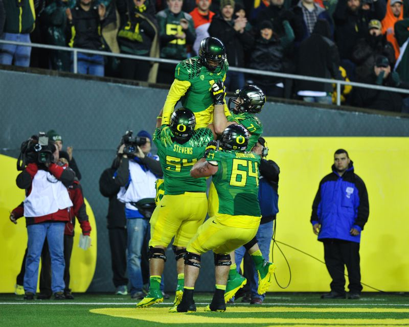 by: COURTESY OF JOHN LARIVIERE - Oregon offensive linemen rush to receiver Josh Huff and give him a ride after his 12-yard TD catch with 7:56 remaining put Oregon back in the lead Friday 30-29.