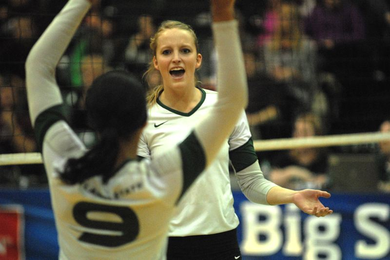 by: PAMPLIN MEDIA GROUP: DAVID BALL - Portland State's Katie O'Brien celebrates a kill with teammate Kaeli Patton during the Vikings' three-set semifinal win over Montana on Friday night.