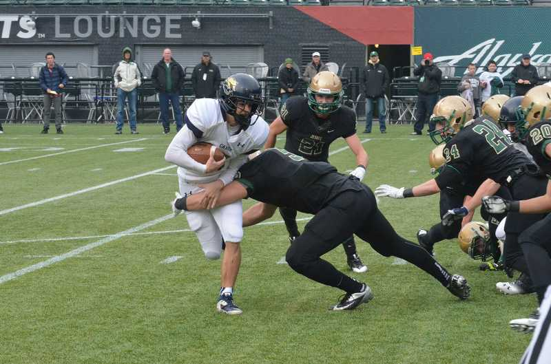 by: JEFF GOODMAN - Noah Kyllo is surrounded by Jesuit defenders Nov. 30 at Jeld-Wen Field in Portland. Kyllo scored two touchdowns, but the Canby football team fell to the top-seeded Crusaders in the Class 6A state semifinals.