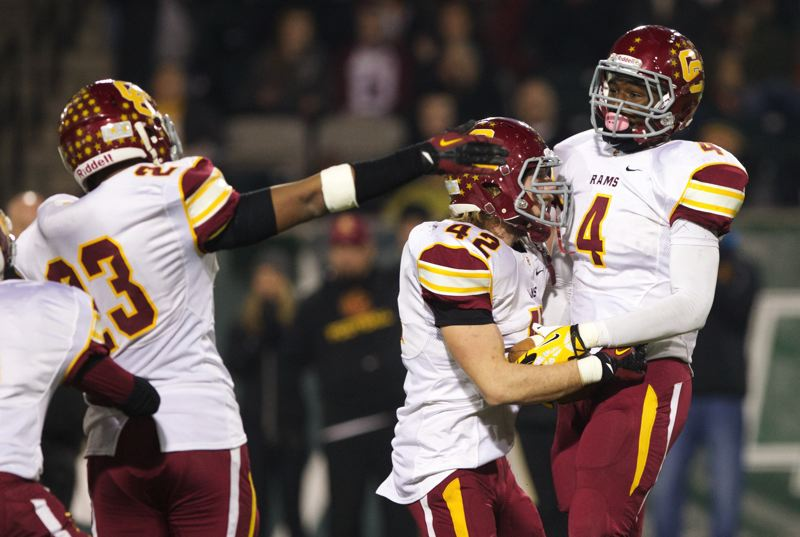 Central Catholic linebacker LaMar Winston (right) celebrates with teammates after recovering a second-half fumble.