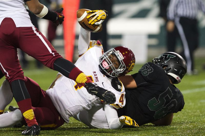 Central Catholic linebacker LaMar Winston recovers a fumble.