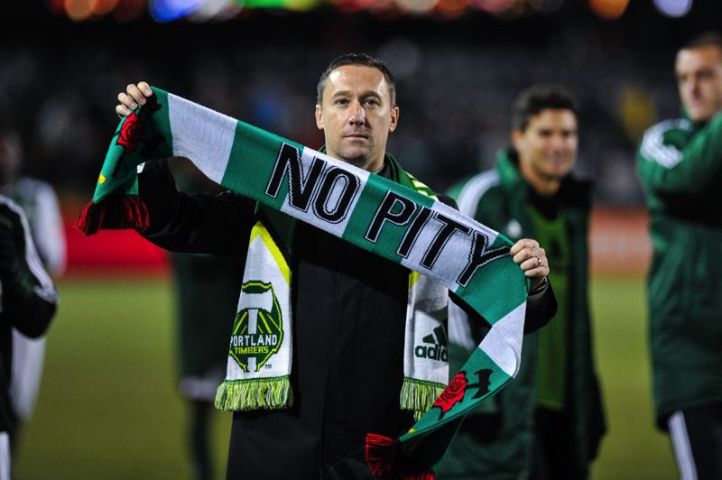 by: TRIBUNE FILE PHOTO - Caleb Porter shows her feelings to the home fans after the Portland Timbers' playoff win over Seattle.