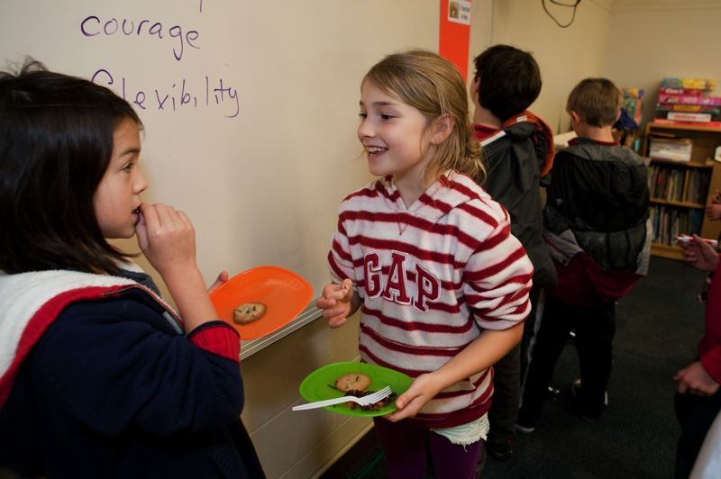 by: PHOTO COURTESY OF KATHARINE KIMBALL - Two third-grade students take their first tastes of the mealworm cookies.