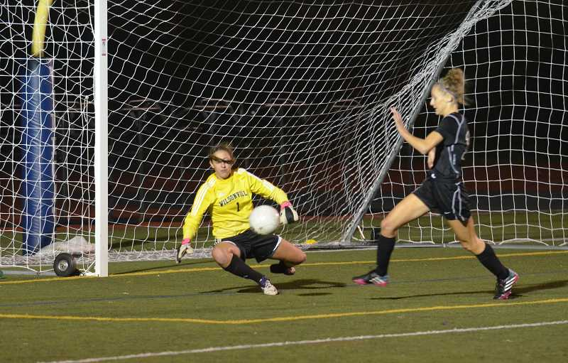 by: JEFF GOODMAN / FILE - Senior goalkeeper Bess Kitzmiller (left) makes a play on the ball Oct. 17 at Randall Stadium, where the Wilsonville girls soccer team shut out rival Sherwood for the first time since 2006.