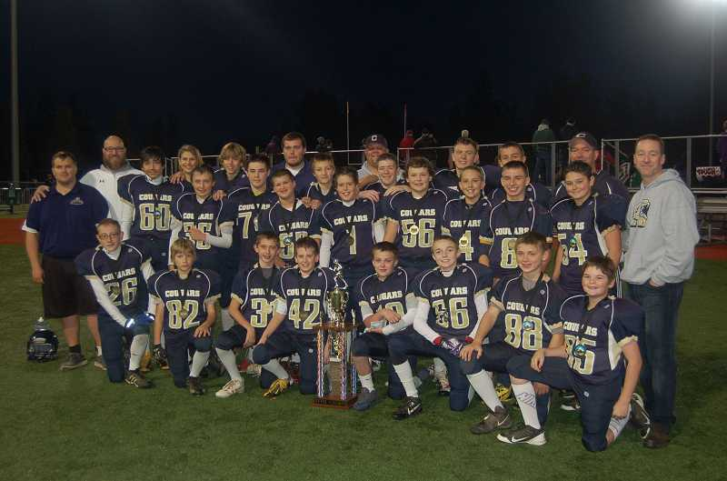 by: SUBMITTED PHOTO - Canby JV Gold won the JV Metro division championship by defeating Lake Oswego JV Navy 38-20 in a Tualatin Valley Youth Football League title game Nov. 9 at Tigard High School.