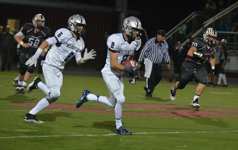 by: JEFF GOODMAN / FILE - The Wilsonville football team finished its 2013 season with a 6-5 record and a 4-3 tally in league play. Above, senior Tyler Carskadon (8) charges upfield after an interception in the Wildcats' loss to Sherwood.