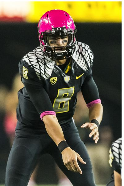 by: COURTESY OF MICHAEL WORKMAN - Oregon QB Marcus Mariota is the all-Pac-12 quarterback for 2013, by vote of the league coaches. Arizona State's Taylor Kelly made the second team at QB.