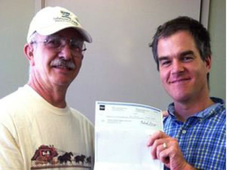 by: PHOTO COURTESY: TOM UNGER - Wells Fargo employee Gary Klein (left) delivers the grant funds to JCWC headquarters and Executive Director Matt Clark.