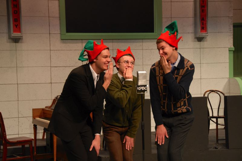 by: PHOTO BY KARMIN TOMLINSON - From left, Sam Babst, Matt Devlin and Stefan Previs, in elf hats, sing a humorous song.