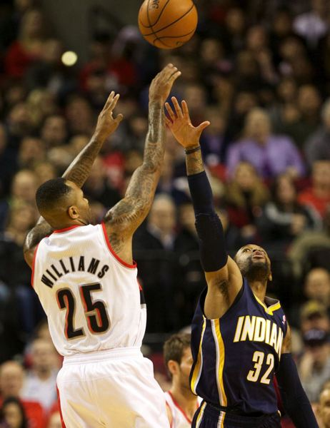Trail Blazers reserve guard Mo Williams fires a jumper over CJ Watson of Indiana.