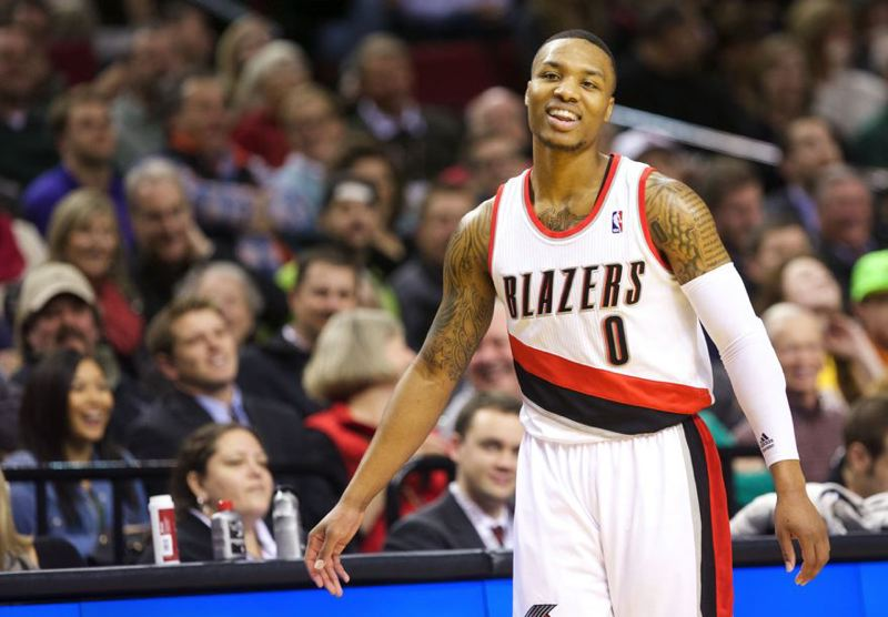 by: TRIBUNE PHOTO: JAIME VALDEZ - Blazers guard Damian Lillard keeps it loose during a first-half timeout.
