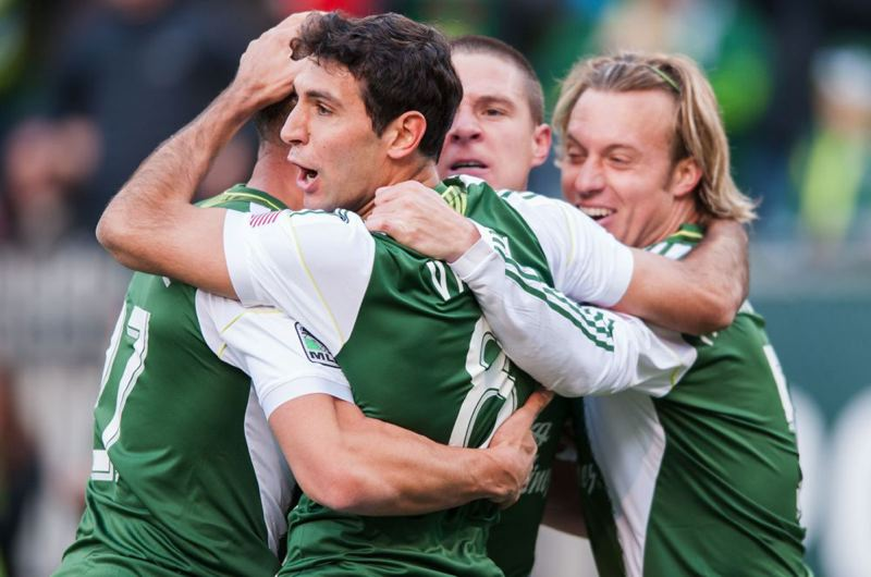 by: TRIBUNE FILE PHOTO: NICK FOCHTMAN - Diego Valeri gets congratulations from Portland Timbers teammates after scoring the first goal of the season at home against New York on March 3.