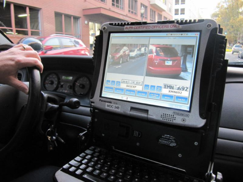 by: KRISTIAN FODEN-VENCIL/OPB - Officer Garrett Dow turns his 'Automatic License Plate Reader' on. It can collect thousands of number plates in a day.
