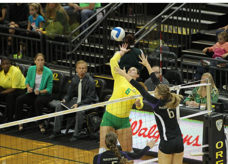 by: COURTESY OF UNIVERSITY OF OREGON - Oregon Ducks star Liz Brenner, hitting against Washington, has made the all-Pac-12 volleyball team for the second year in a row.