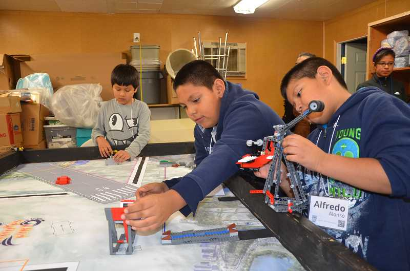 by: MARY STEWART - (From left) Alfredo Alonso, Michael Mendoza and Andrew Nava enjoy practicing the lessons learned in the classroom in the fun and low pressure afterschool 4-H Club setting.