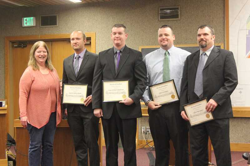 by: LINDSAY KEEFER - Mayor Kathy Figley recognized (from left) Sgt. Andy Shadrin, Cpl. Shawn Hershberger, Officer Josh Rains and Officer Tom Courson at the Nov. 25 city council meeting. The group received Medals of Honor from the Oregon Peace Officers Association. Officer Bill Nightingale also received the Lifesaving Award.
