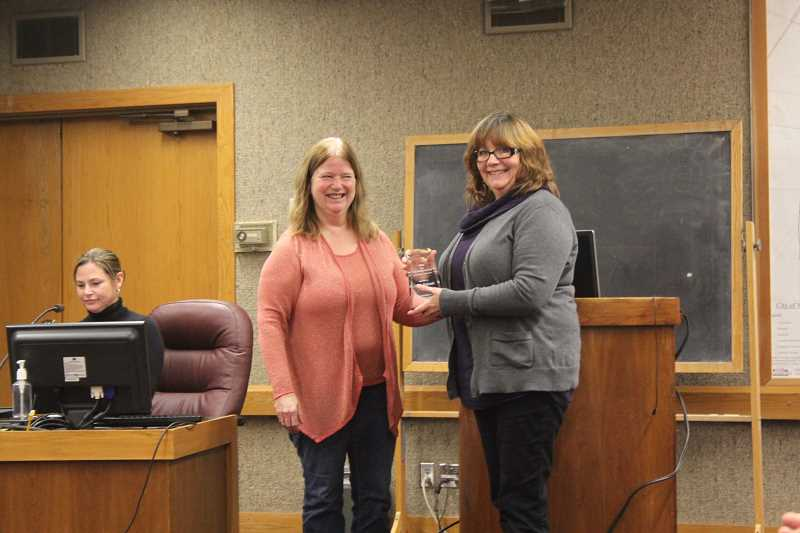 by: LINDSAY KEEFER - Mayor Kathy Figley (left) presented the Mary Tennant Award for Excellence in Public Service to Linda Eubank at Nov. 25's Woodburn City Council meeting.