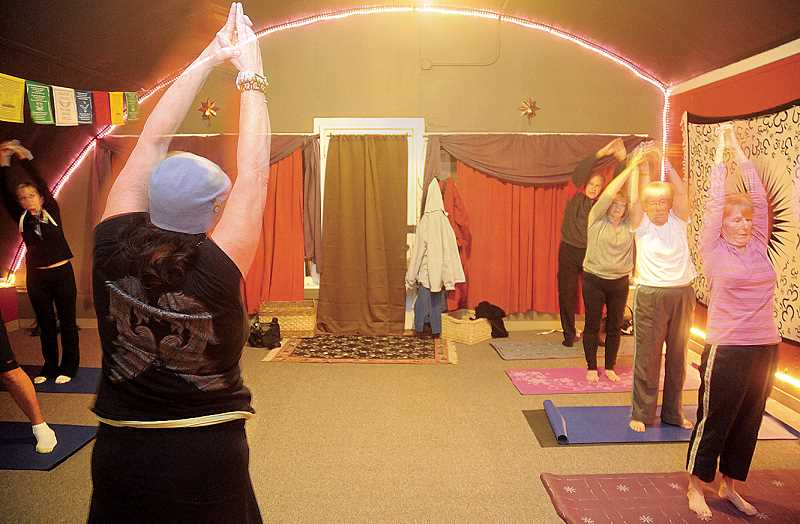 by: GARY ALLEN - Health -- Christine Kirk teaches a yoga class Monday at the business' new location on Blaine Street.