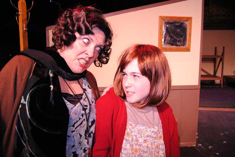 by: COURTESY PHOTO: THEATRE IN THE GROVE - Jeanna VanDyke, as Miss Hannigan, threatens Annie, played by Mackenzie Gross.