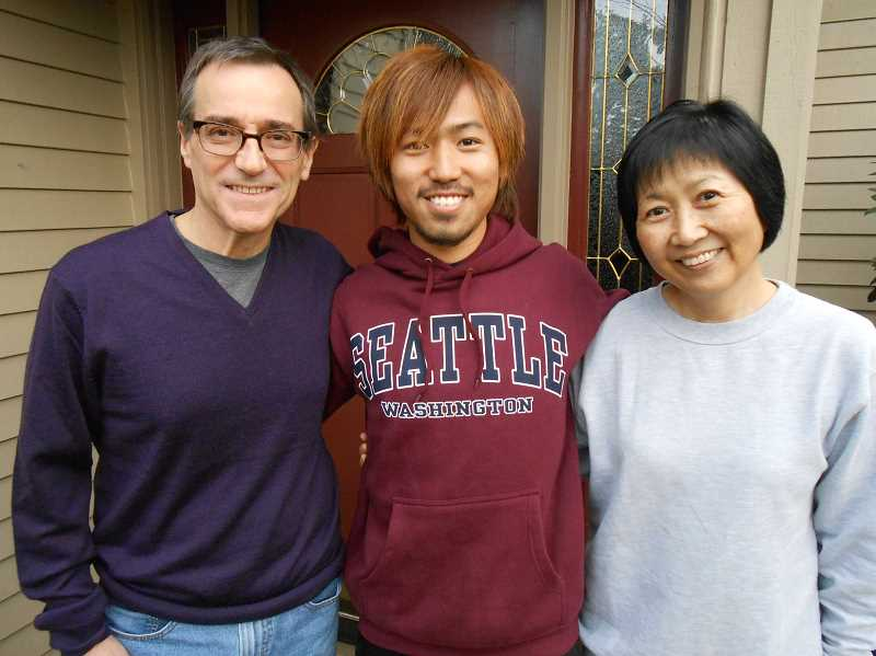 by: SUBMITTED PHOTO - Yuichi Tsuchida made two good Lake Oswego friends on his long trip, Fukumi and Larry Hauser. Tsuchidas highlight here was experiencing a Thanksgiving dinner for the first time.