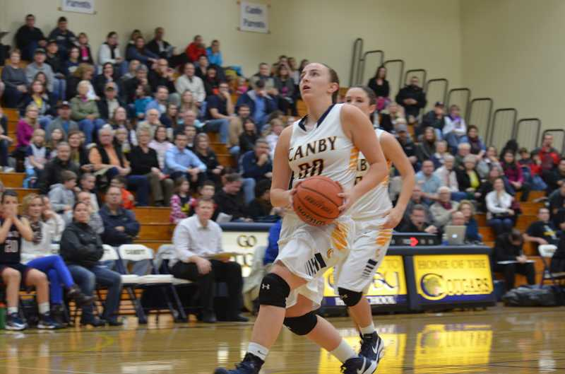 by: JEFF GOODMAN / FILE - Taylor Lee, shown during a home game last season, will be a major contributor for the Canby girls basketball team once she recovers from a knee sprain. Two other players, Cianne C ates and Lindsey Wujek, are out for the year due to knee injuries.