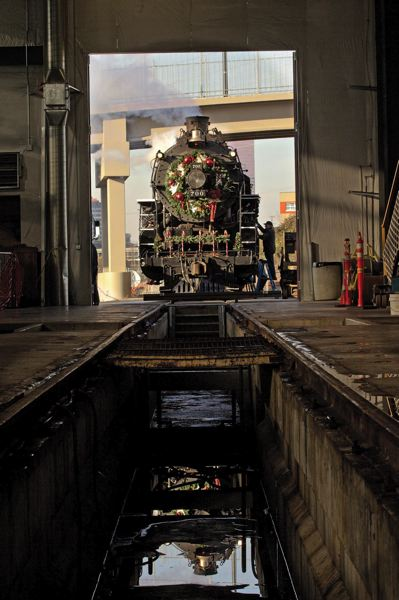by: TRIBUNE PHOTO: JAIME VALDEZ - Looking through the Enginehouse and Oregon Rail Heritage Center as volunteers clean the SP&S 700 before its first Holiday Express ride.