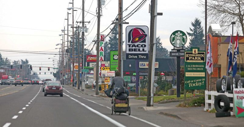 by: TRIBUNE PHOTO: JONATHAN HOUSE - The Midway area, shown here on Division Street near Southeast 122nd Avenue, could become a major commercial hub if Portlands updated comprehensive plan designates it as a town center, and public investment follows.