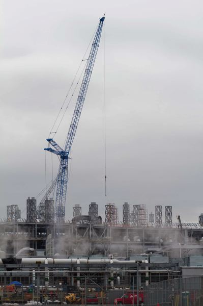 by: TRIBUNE PHOTO: CHASE ALLGOOD - Construction continues on Intels DX2 plant despite controversy over the companys emission permit.