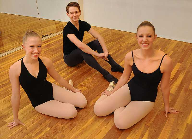 by: REVIEW PHOTO: VERN UYETAKE - Local teens Audrey Wells, left, and Madeline Robertson are practicing for The Nutcracker and Holiday Showcase this month with help from fellow performer Jonas Berger of Beaverton.