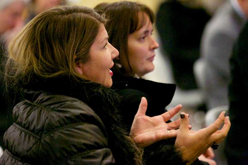 by: TIMES PHOTO: JAIME VALDEZ - Dena Gentry expresses her concerns to Dick Steinbrugge, an executive administrator with Beaverton School District, about the future plans to Springville K-8 School during a community open house at Beaverton High School.