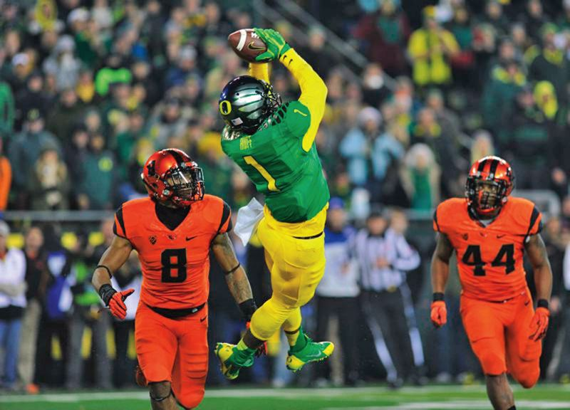 by: COURTESY OF JOHN LARIVIERE - Oregon wide receiver Josh Huff comes down with the ball in the end zone for the winning touchdown in last weeks Civil War game against Oregon State.