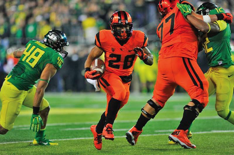 by: COURTESY OF JOHN LARIVIERE - Oregon State receiver Victor Bolden turns the corner to score from 25 yards on a fly sweep, giving the Beavers a late lead in last weeks Civil War at Autzen Stadium.