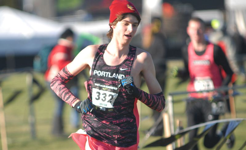 by: PORTLAND TRIBUNE: DAVID BALL - Central Catholics Zackeria Lavier leads a pack of runners around a turn on the Portland Meadows course Saturday.
