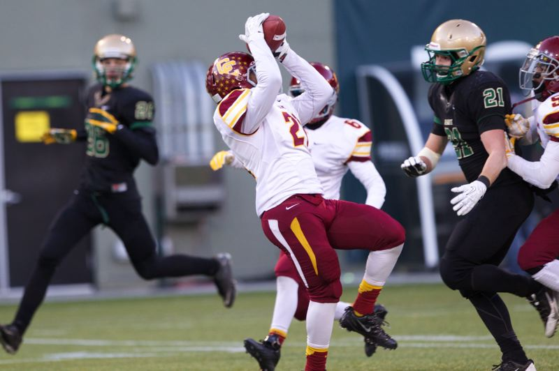 Aaron Washington intercepts a Jesuit pass.