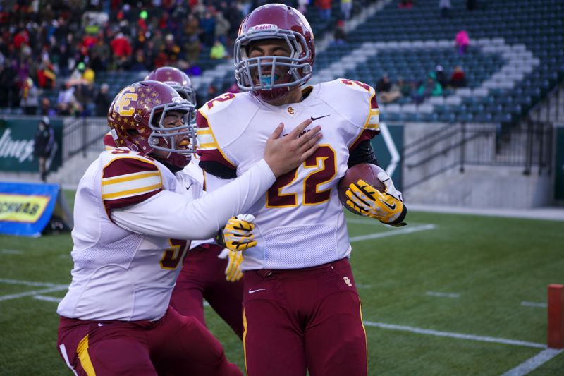 TJ Salu congratulates Cameron Scarlett after his touchdown run.