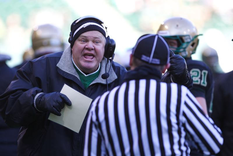 Jesuit coach Ken Potter tells a referee to watch for holding.