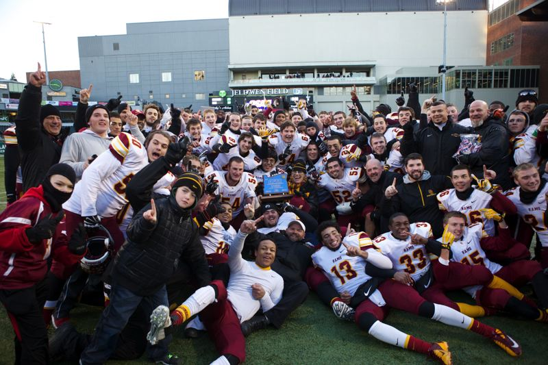 by: TRIBUNE PHOTO: JAIME VALDEZ - The 2013 state champion Central Catholic Rams pose for photos, moments after they climaxed a 14-0 season with a 38-28 victory over Jesuit in the Class 6A title game at Jeld-Wen Field.