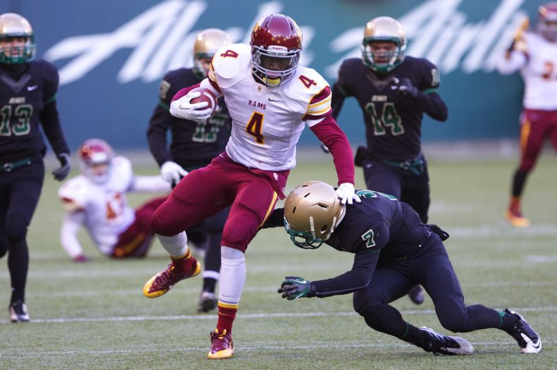 LaMar Winston of Central Catholic returns a kickoff, as Matthew Ferguson goes low in his tackle attempt for Jesuit.