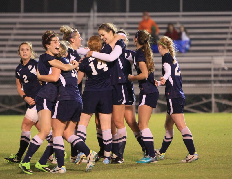 by: COURTESY OF CONCORDIA UNIVERSITY - The Concordia Cavaliers celebrate the goal by Hannah Scott (14) that would prove to be the national championship-winner Saturday at Orange Beach, Ala.