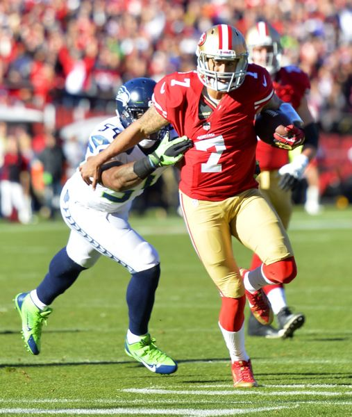 by: COURTESY  OF MICHAEL WORKMAN - San Francisco 49ers quarterback Colin Kaepernick picks up yardage on a run Sunday versus Seattle.